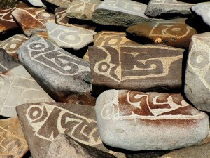 Ali in Tibet with Mani stones